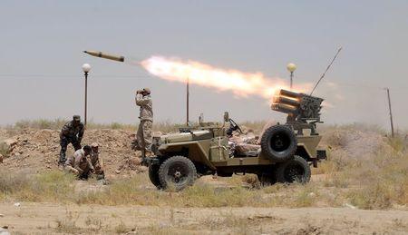 Car bombing at Baghdad checkpoint kills 8