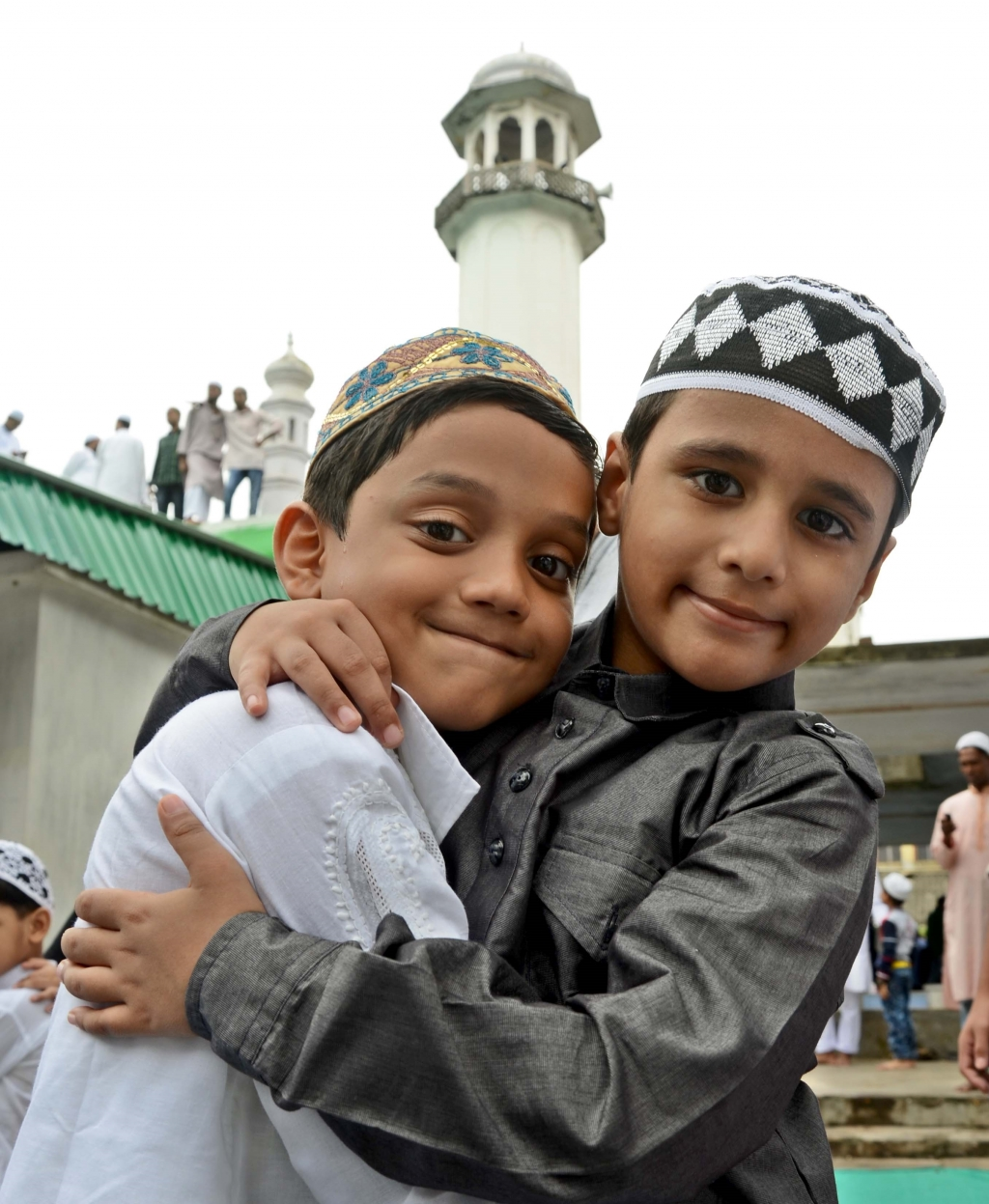 Children exchange Eid greetings after offering namaz outside a mosque in Bhubaneswar on Saturday | EXPRESS