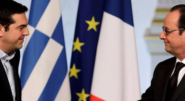 French President Francois Hollande and Greek Prime Minister Alexis Tsipras at a meeting at the Elysee Palace in Paris. Hollande stated during the visit by Alexis Tsipras that European Union rules and debt commitments must apply to all