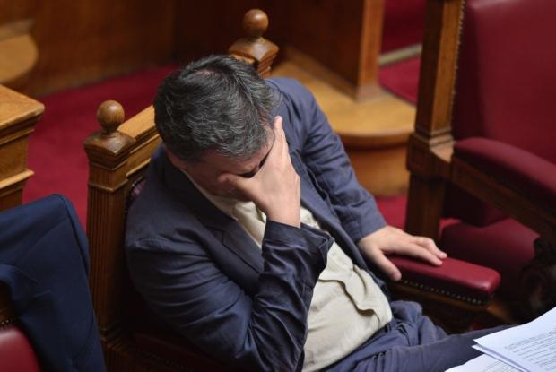 Greek finance minister Euclid Tsakalotos looks downcast
