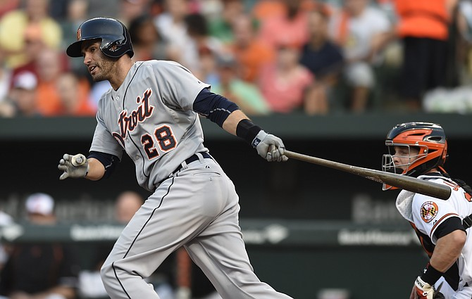 Detroit Tigers&#39 J.D. Martinez follows through on a two run double against the Baltimore Orioles in the first inning Thursday in Baltimore