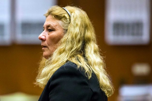 Mary O'Callaghan stands after the reading of the verdict for her trial at the Clara Shortridge Foltz Criminal Justice Center in Los Angeles. O'Callaghan was sentenced to 16 months in jail for kicking and striking