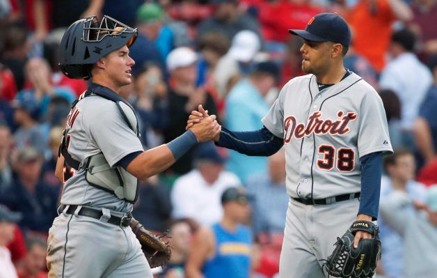 Detroit Tigers James McCann left and Joakim Soria celebrate after the Tigers defeated the Boston Red Sox 5-1 in a baseball game in Boston Saturday