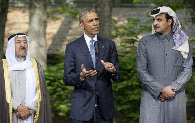 President Barack Obama center with Kuwaiti Emir Sheikh Sabah Al-Ahmad