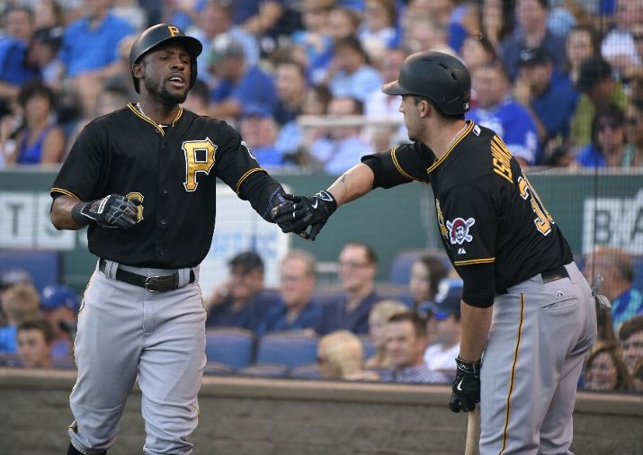 Pirates pull away following late rally in win