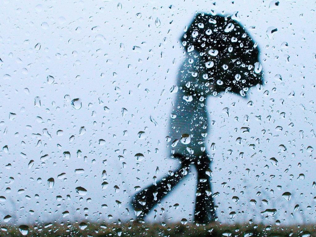 Woman walks through the rain