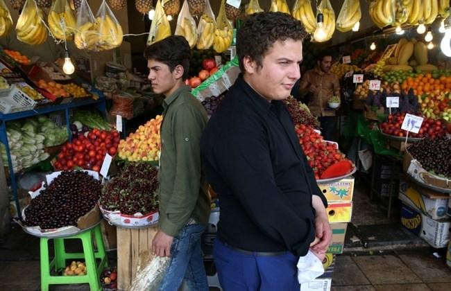 Two Iranian fruit sellers wait for the customer in Tajrish bazaar northern Tehran Iran Tuesday