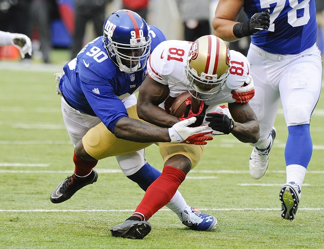 New York Giants defensive end Jason Pierre Paul tackles San Francisco 49ers wide receiver Anquan Boldin during the first half of an NFL football game Sunday Nov. 16 2014 in East Rutherford N.J