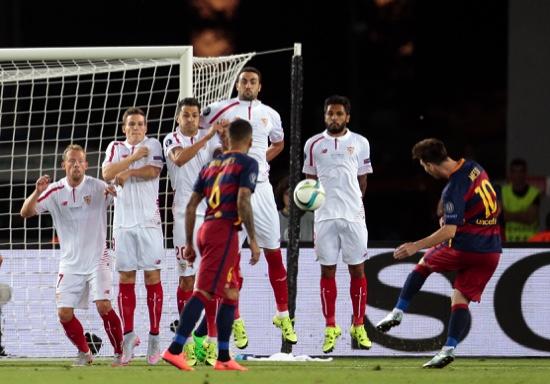 Barcelona's Lionel Messi shoots a free kick