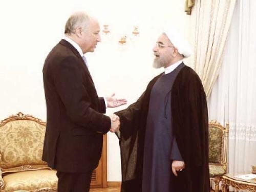 France seeks to warm up Iran ties with Rohani invite