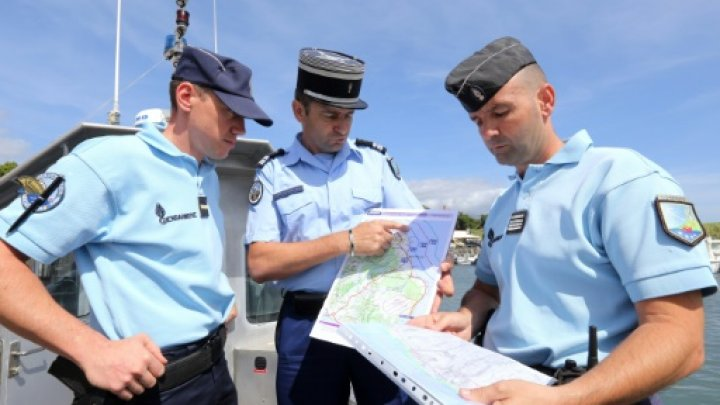 AFP  File   French maritime gendarmes look at a map indicating measures being undertaken in the search for wreckage from the missing MH370 plane at the marina of Saint Marie on the French island of La Reunion