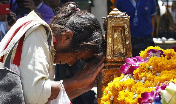 A woman prays at the shrine