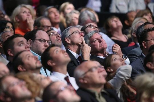 Audience members look