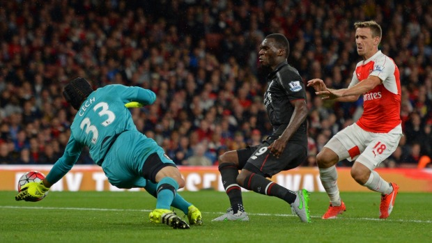 Liverpool's Christian Benteke centre is denied by Arsenal goalkeeper Petr Cech at the Emirates Stadium