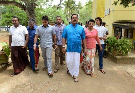 Sri Lanka's former President Mahinda Rajapaksa arrives at a polling station during the general election in Medamulana