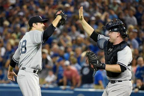 Yankees retake top position by ending Blue Jays win streak   0