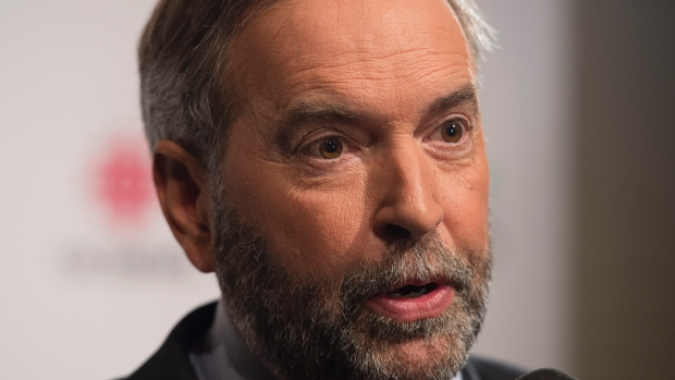 NDP Leader Tom Mulcair says 'We have very smart experienced people around us who are looking at the shape of things to come as we wait for our result.&#39