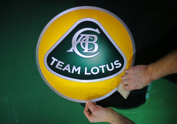 AFP  File  Carl de SouzaA man prepares panel boards with the new F1 Team Lotus logo at their headquarters in Hingham Norfolk eastern England