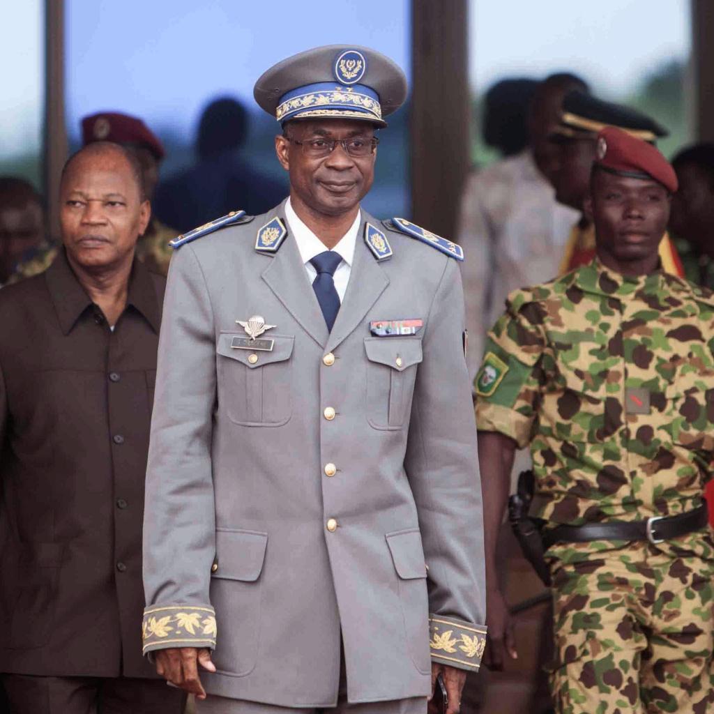 Burkina Faso coup leader Gen. Gilbert Diendere waits for Senegal President Macky Sall to arrive at the airport for talks in Ouagadougou Burkina Faso last week