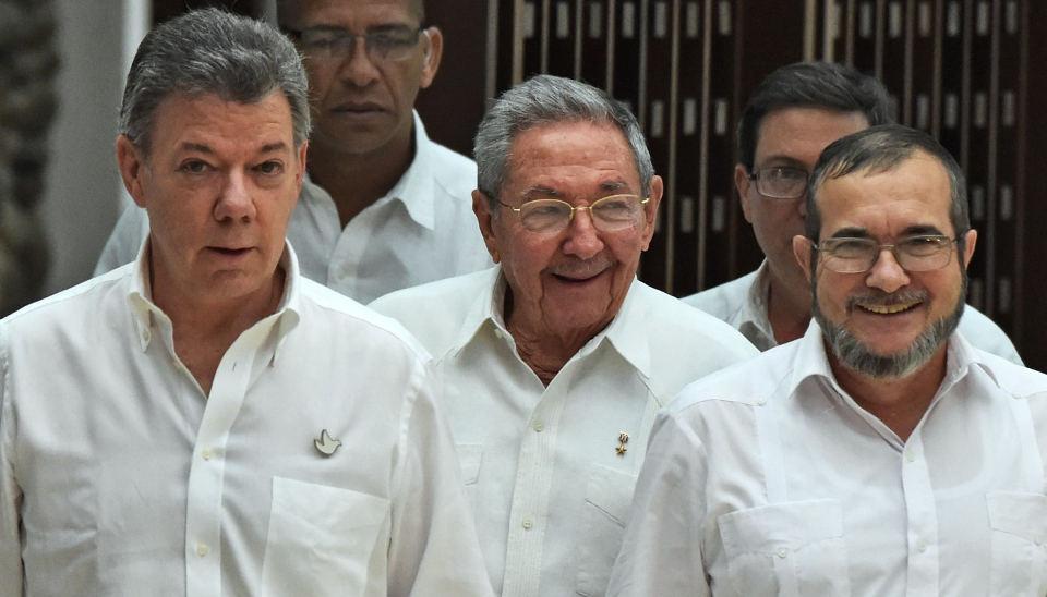 "Colombian President Juan Manuel Santos, Cuban Presisdent Rual Castro and FARC leader Timoleom Jimenez alias ""Timochenko,"""