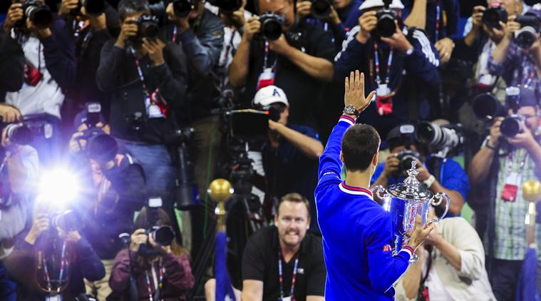 Novak Djokovic of Serbia celebrates after beating Roger Federer of Switzerland in the men's championship match of the U.S. Open tennis tournament. | AP
