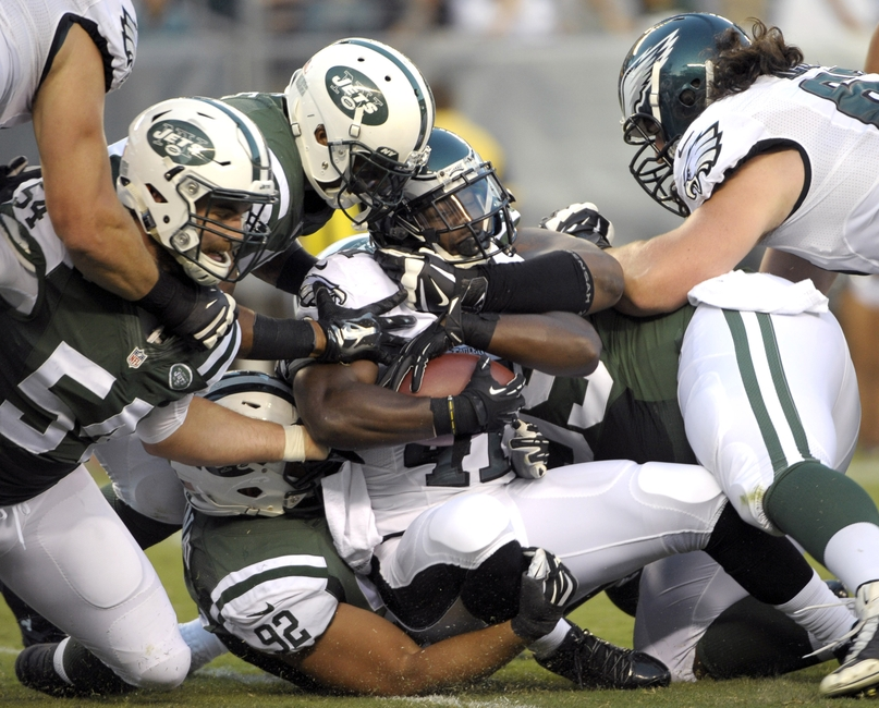 Aug 28 2014 Philadelphia PA USA Philadelphia Eagles running back Kenjon Barner is tackled by New York Jets linebacker Nick Bellore, defensive back Rontez Miles, defensive tackle Tevita Finau and defensive tackle T.J. Barnes