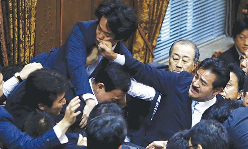 TOKYO Ruling and opposition lawmakers come to blows during a meeting of a committee of the upper house of the National Diet here on Thursday.—Reuters