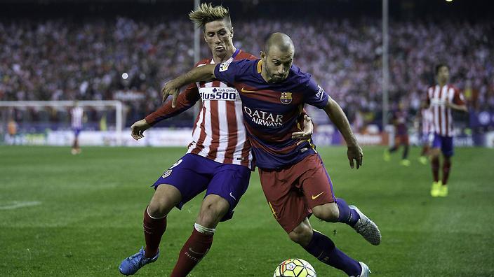 Javier Mascherano holds off Fernando Torres.                                                  Show Grid