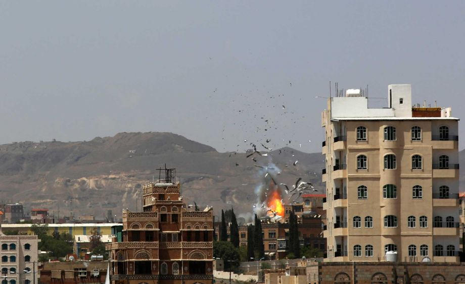 Debris and smoke rise after a Saudi-led airstrike hits an army base in Sanaa Yemen Monday Sept. 14 2015. Saudi Arabia is leading a coalition of mainly Gulf nations fighting Shiite Yemeni rebels known as the Houthis who are allied with army units loya