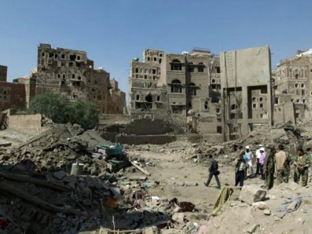 Yemenis inspect the rubble of UNESCO-listed buildings that were destroyed by air strikes carried out by the Saudi-led coalition in the Al Falihi neighbourhood in Sanaa's old city