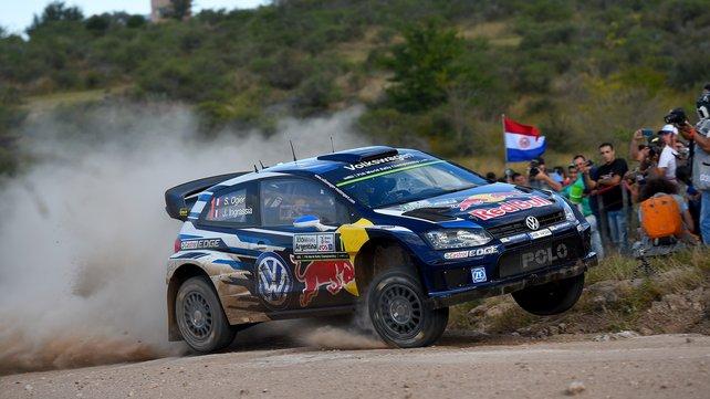 Sebastian Ogier flies in his Volkswagen Polo R en route to a third consecutive World Rally Championship title