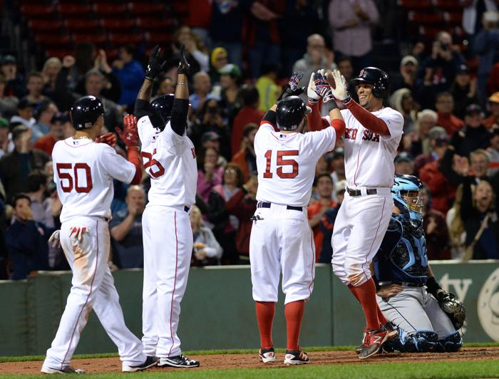 BOSTON MA- SEPTEMBER 21 Xander Bogaerts #2 of the Boston Red Sox slaps high fives after a grand slam to retake the lead in the eighth inning against the Tampa Bay Rays at Fenway Park