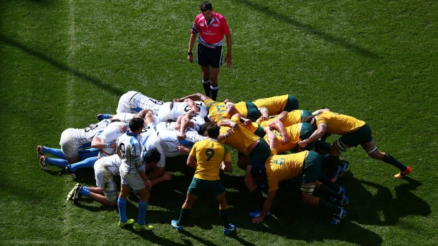 Wallaby Nick Phipps prepares to put the ball into the scrum during the pool A match between Australia and Uruguay in Birmingham on Sunday