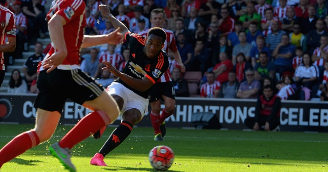 SOUTHAMPTON ENGLAND- SEPTEMBER 20 Anthony Martial of Manchester United scores their first goal during the Barclays Premier League match between Southampton and Manchester United at St Mary's Stadium