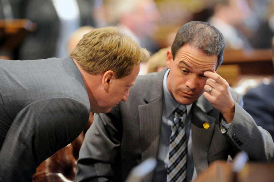 House Democratic Leader Rep. Tim Greimel left and House Speaker Rep. Kevin Cotter right speak Thursday Sept. 10 2015 in Lansing Mich. The Michigan House was at a standstill Thursday night over whether to expel Rep. Cindy Gamrat and Rep. Todd Cou