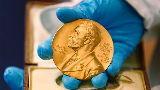 17 2015 A national libray employee shows the gold Nobel Prize medal awarded to the late novelist Gabriel Garcia Marquez in Bogota Colombia. The beginning of October 2015 means Nobel Prize time when committ