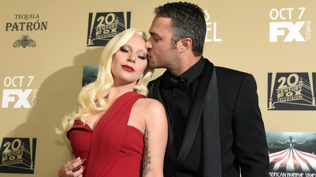 Lady Gaga raves about American Horror Story Hotel role as she takes her man Taylor to show premiere