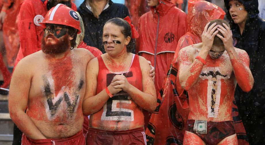 Georgia fans sporting the letters W-E-T in the pouring rain react as Alabama scores a touchdown during an NCAA college football game Saturday Oct. 3 2015 in Athens Ga.  MARIETTA DAILY OUT GWINNE