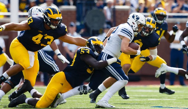 Sep 26 2015 Ann Arbor MI USA Brigham Young Cougars quarterback Tanner Mangum is tackled by Michigan Wolverines defensive end Mario Ojemudia in the third quarter at Michigan Stadium. Michigan won 31-0. Mandatory Credit Rick Osentoski-USA TO