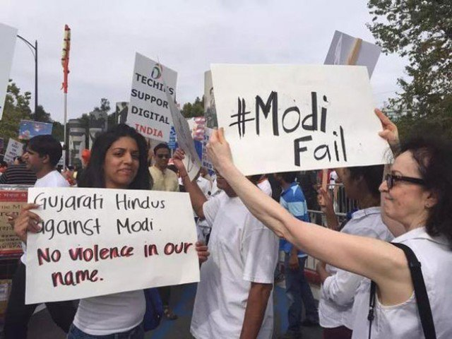 Protesters hold a protest against Indian Prime Minister Narendra Modi who recently visited Silicon Valley and met Facebook CEO Mark Zuckerberg
