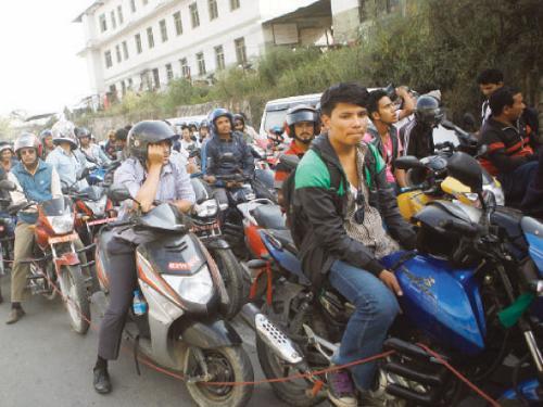 Nepalis adapt to fuel shortage by carpooling riding bikes