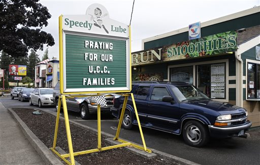 A sign in remembrance for those killed in a fatal shooting at Umpqua Community College is displayed at a local business Saturday Oct. 3 2015 in Roseburg Ore. Armed with multiple guns Chris Harper Mercer 26 walked in a classroom at the community
