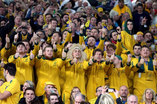 PA Wire Australia fans celebrate victory at Twickenham