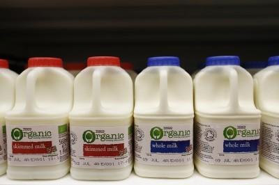 Plastic cartons of organic skimmed milk left and whole milk