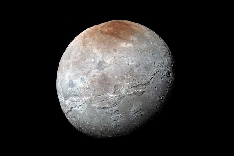 pluto�s moon charon reveals its history celebcafeorg
