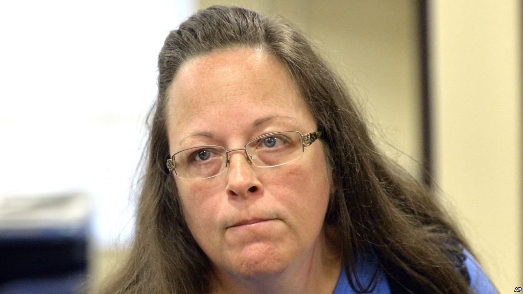 Rowan County Clerk Kim Davis listens to a customer following her office's refusal to issue marriage licenses at the Rowan County Courthouse in Morehead Ky. Sept. 1 2015