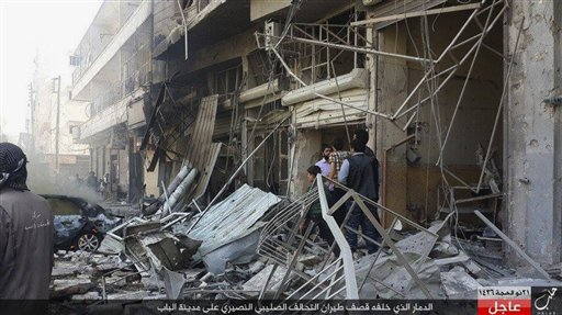 Rased News Network a Facebook account affiliated with Islamic State militants which has been authenticated based on its contents and other AP reporting people gather at the site of an airstrike in Al-B