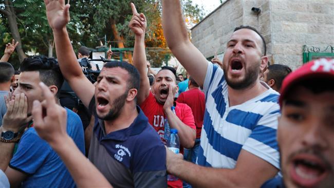 Palestinian protestors shout slogans during a demonstration in Jerusalem al Quds