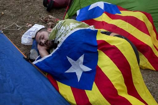Spain police raid Catalan govt offices