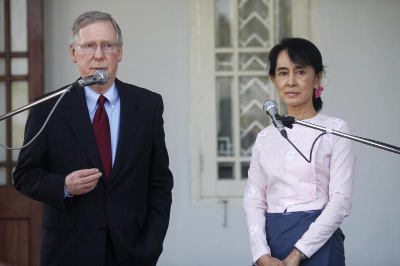 US Senator Mitch McConnell left talks to reporters after meeting Aung San Suu Kyi at her home in Rangoon on 16 January 2012